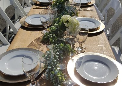 Farm Table and Decor and White Folding Chairs
