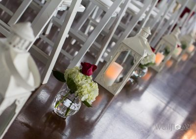 Aisle decor lanterns vases with flowers