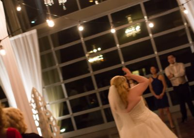 Chandelier over bouquet toss
